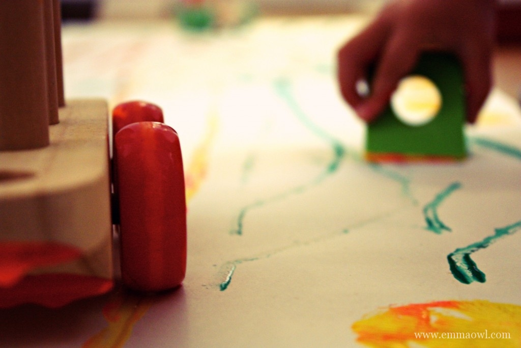 Painting with Trains! What a great little boys activity